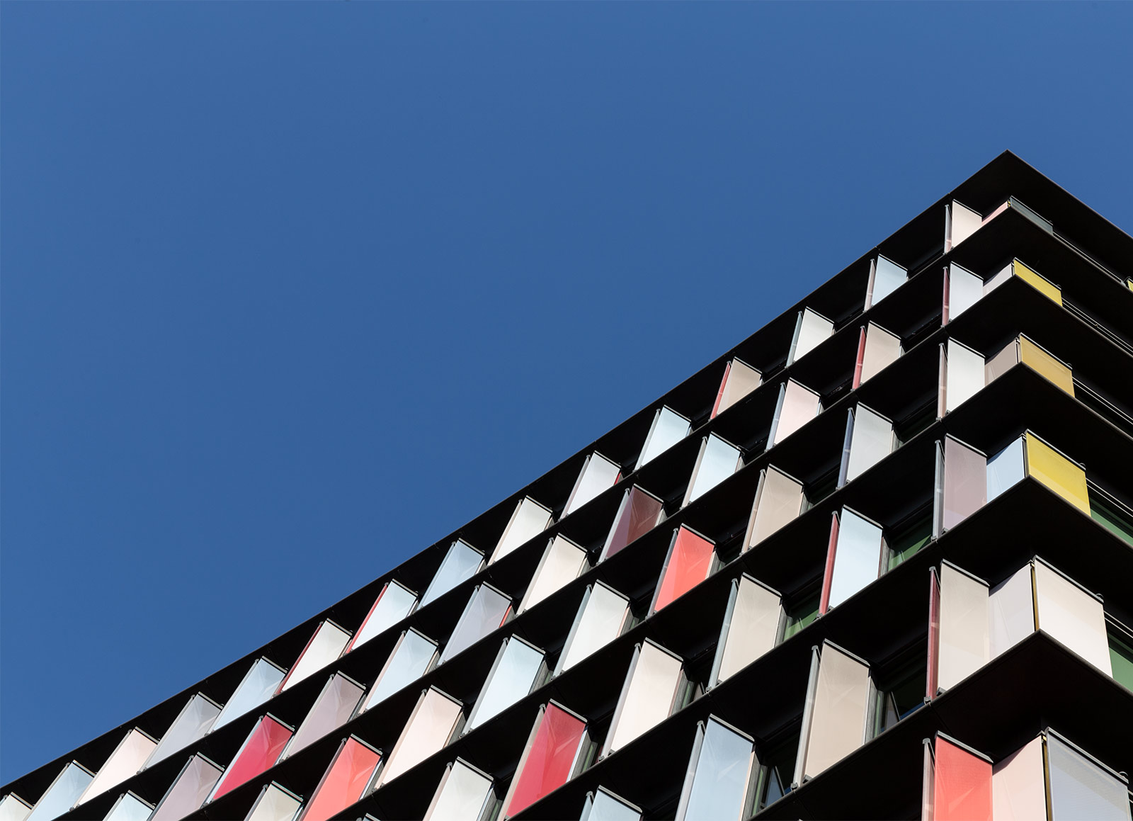 Commercial property image of a colourful glass building